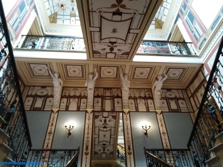 Magnificent views of the ceiling decorations as the visitor goes up the staircases.